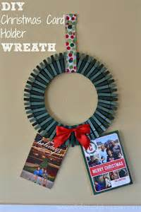 Diy christmas card holder wreath to display all the great photo cards