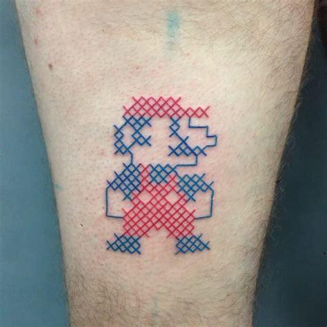 tattoo gun cross stitch 16 cool and geeky mario tattoos tattoodo