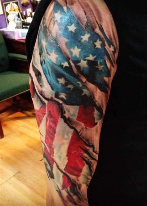 american flag ripping through skin tattoo realistic ripped skin tattoos realistic american