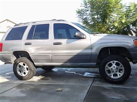 find used lifted jeep grand cheokee laredo in perris