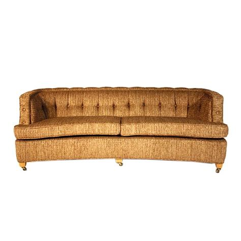 curved dunbar sofa with tufted back and arms