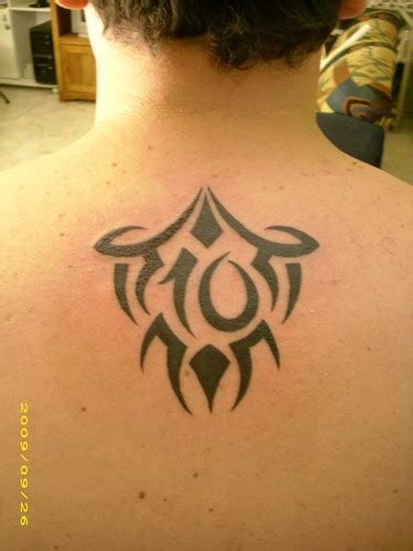 zimbio celebrity upper back tattoos for men tribal