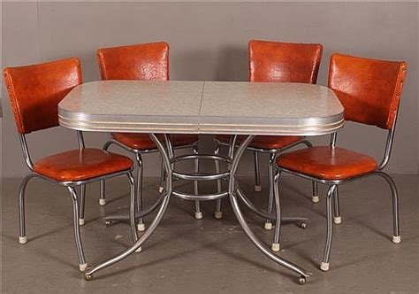 formica top kitchen table with 4 orange vinyl chairs wi
