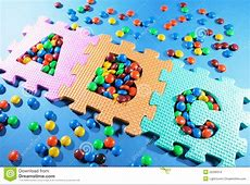 Alphabet Puzzles And Chocolate Lollies Stock Images ... Junk Food Background