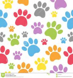 An abstract seamless pattern with colourful dog paw prints on white