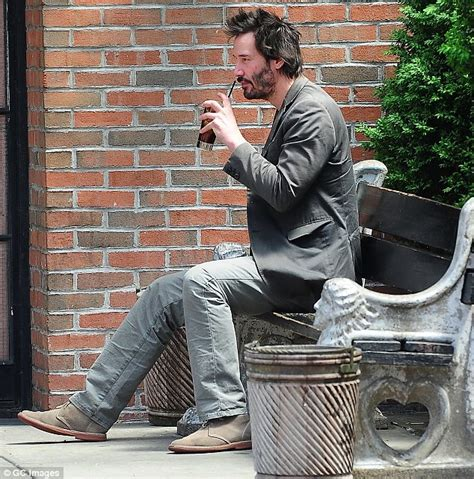 keanu reeves bench keanu reeves has a solitary drink outside his nyc hotel