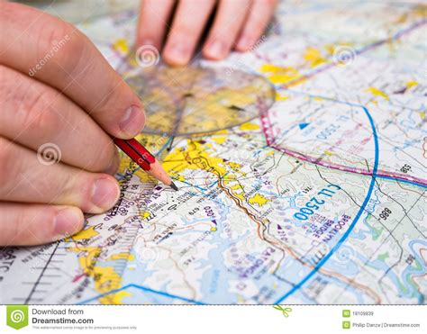 Stock United Healthcare Pilot Plotting A Course On A Map Royalty Free Stock Images