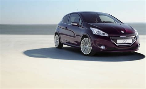 peugeot 101 car gm buys back stock from u s government chops plans with