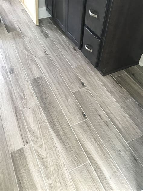 Grey Bathroom Floor by Newly Installed Gray Weathered Wood Plank Tile Flooring