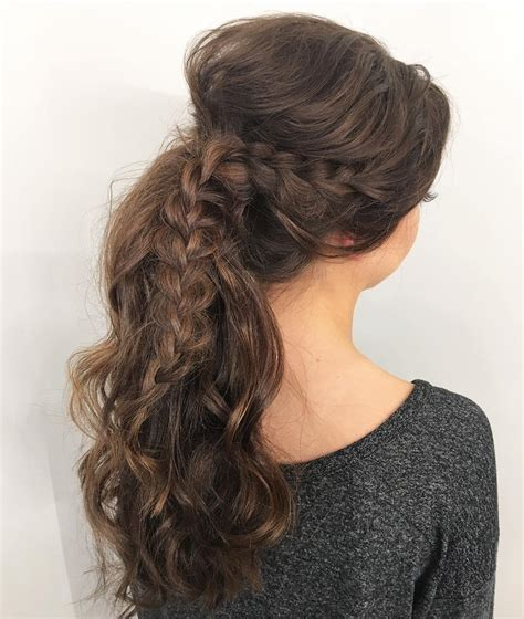 30 eye catching ways to style curly and wavy ponytails bumps from tight braids 30 eye catching ways to style
