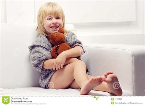 little girl couches little girl with bear on sofa stock image image 27775033
