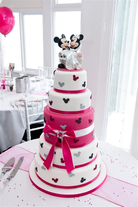 Our disney wedding cake we got married September 1st 2012 and had a disney themed wedding I love