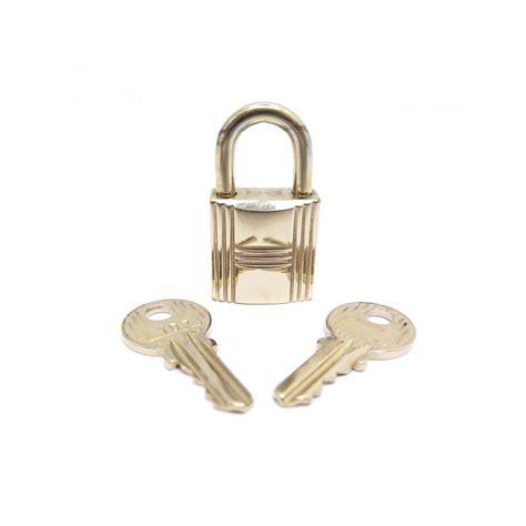 cadenas pour sac hermes cadenas hermes 107 en metal dore avec 2 cles pour sac