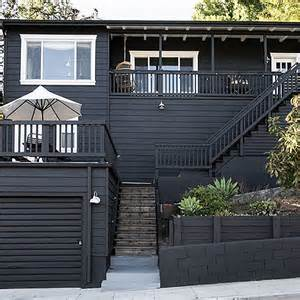 black wood paint exterior paint it black 16 mysterious houses that joined the