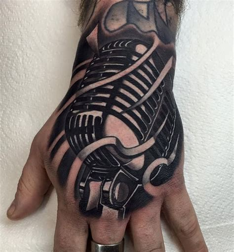 tattoo left hand meaning retro microphone tattoo on left hand