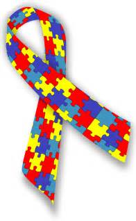 Image description image is of a ribbon with small puzzle pieces in