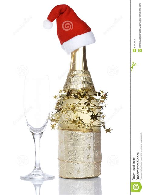chagne bottle with red christmas hat stock photo