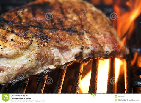 flaming rooster bbq rib loin flaming barbecue ribs on a grill stock image image 1276833