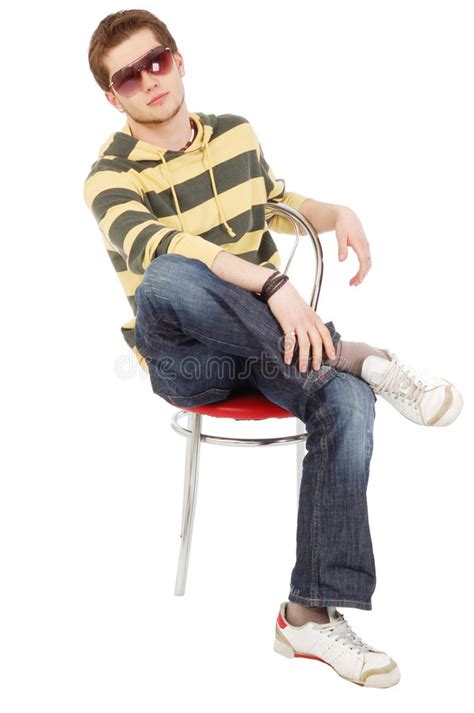sit in the chair or sit on the chair sit on chair cross one s legs stock image
