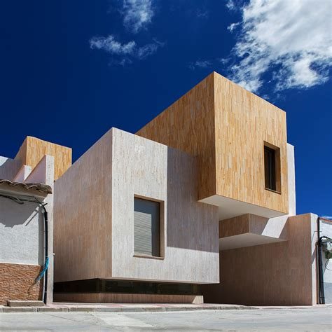 houses for r stone covered blocks make up staggered spanish residence