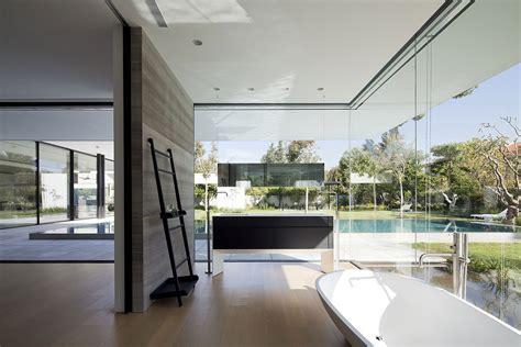 glass wall house 1 e architect bathroom bath sink glass walls float house in tel aviv