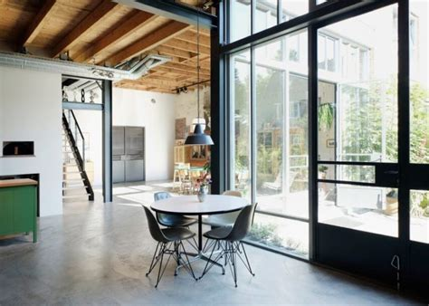 mixing mid century modern and rustic industrial and mid century modern loft in an old barn