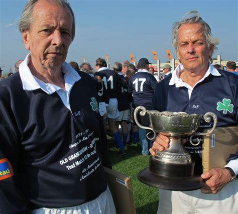 Aliv Trophy 1 survivors of the andes plane crash daniel fernandez and eduardo strauch hold a commemorative