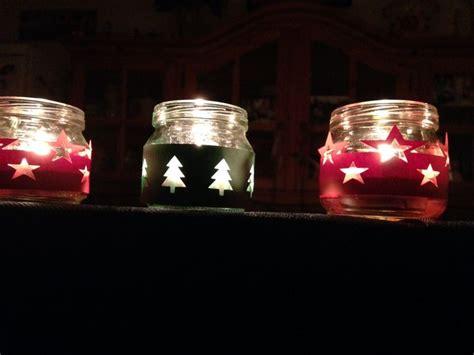 lavoretti con candele candele di natale fatte con i vasetti degli