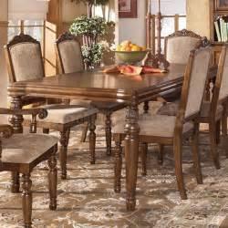 San martin rectangular extension dining table signature design by