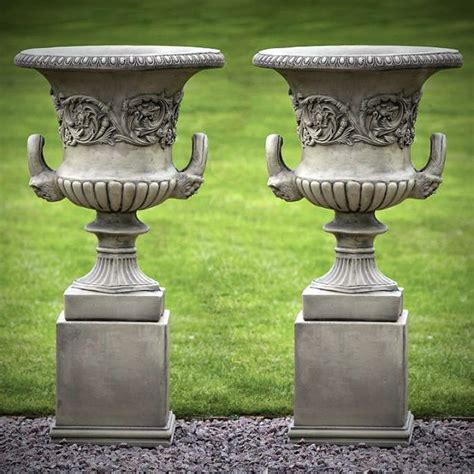 pair of large grecian urns with plinths garden urns