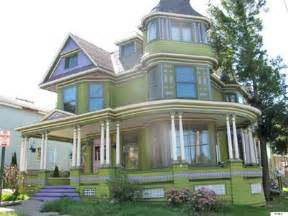 Farmhouse Plans With Wrap Around Porches victorian home accented in purple for sale in new york