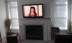 flat screen tv over fireplace ideas for making it look