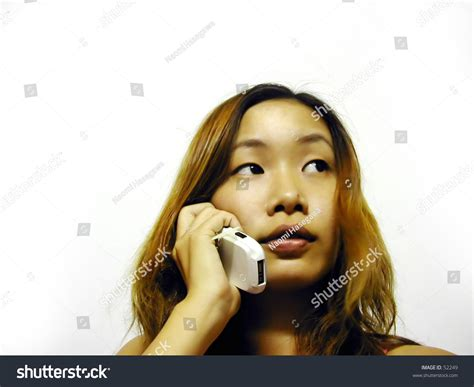 who is the asian girl in the mobile strike commercial asian girl on the mobile phone stock photo 52249