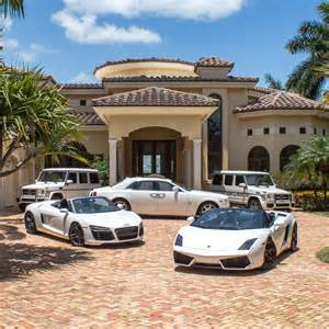 golden beach waterfront mansion for sale exotic car