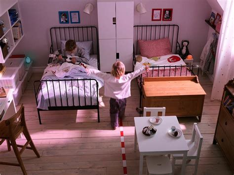 the iron room bedroom shared bedroom design with black iron bed frames and cozy blankets combine with