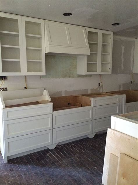 kitchen cabinet hoods lots of lower cabinet drawers simple shaker styling