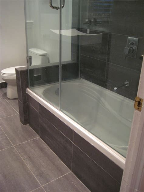Small Bathroom Tub Ideas Black Bathroom With Wooden Pattern Tiles Carrying Drop In Bathtub With Shower Also Glass
