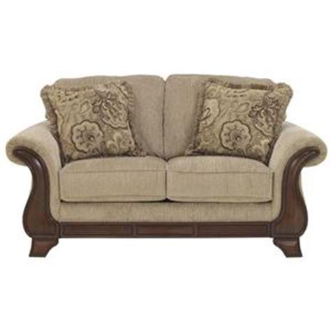 sofa mart spokane valley signature design by ashley lanett ottoman with shaped wood