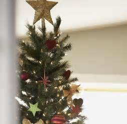 debenhams christmas trees debenhams pledge to revive the tradition for tree topping even though most shoppers now