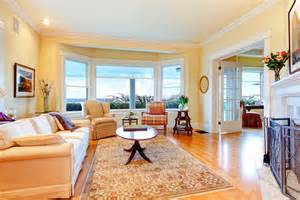 pale yellow living room choosing colors by room to set the mood