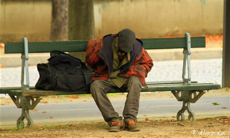 homeless bench homeless man resting on bench in paris flickr photo