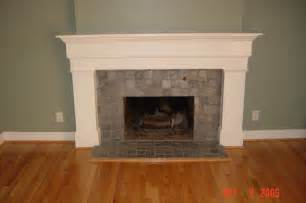 colonial mantel with slate tile surround