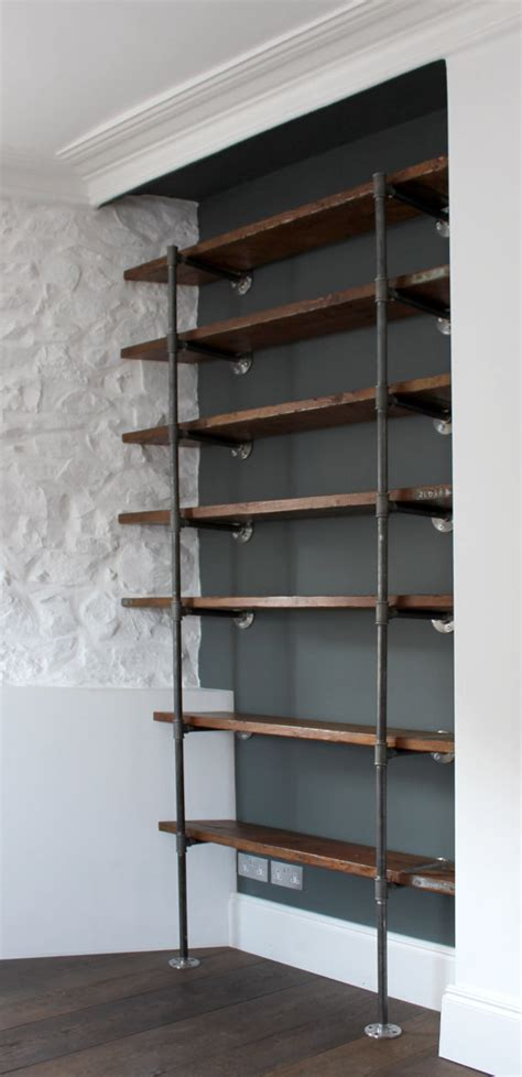 reclaimed scaffolding boards and steel pipe wall mounted