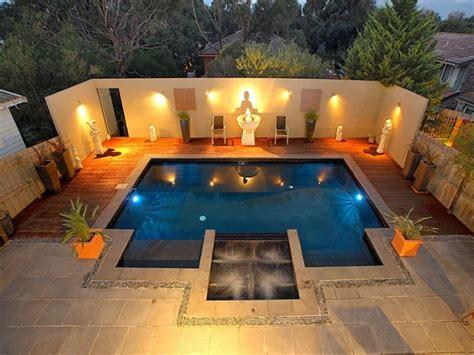 lighting around pool area geometric pool design using slate with decking ground