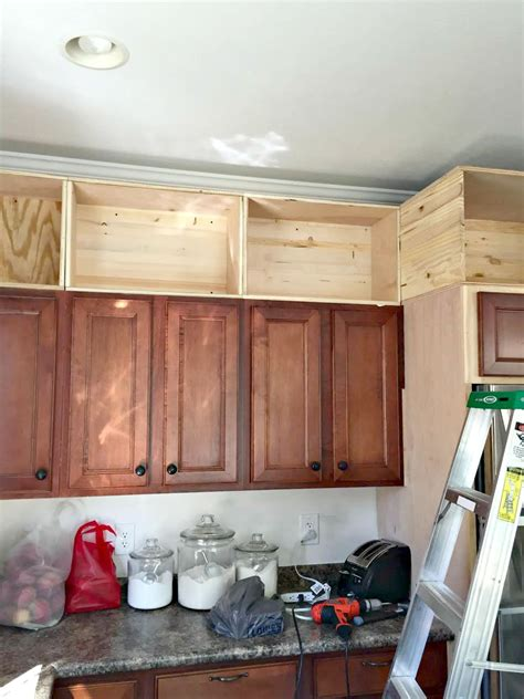 adding molding to kitchen cabinets