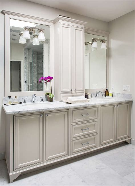 gorgeous master bathroom features a light grey