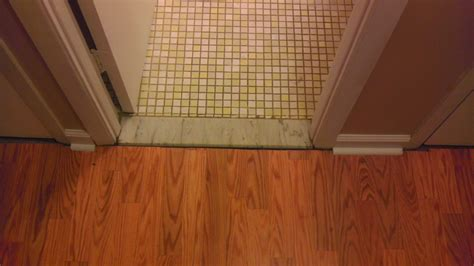 threshold bathroom previous owner did an awful job installing laminate flooring ideas to fix unfinished