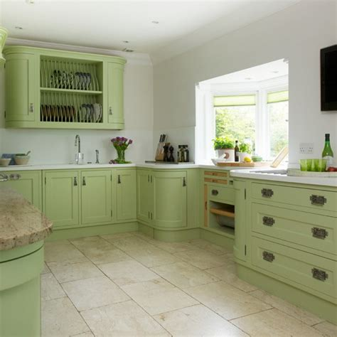 painting kitchen cabinets green green painted kitchen with storage housetohome co uk