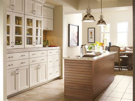 omega cabinets for a transitional kitchen with a pendant