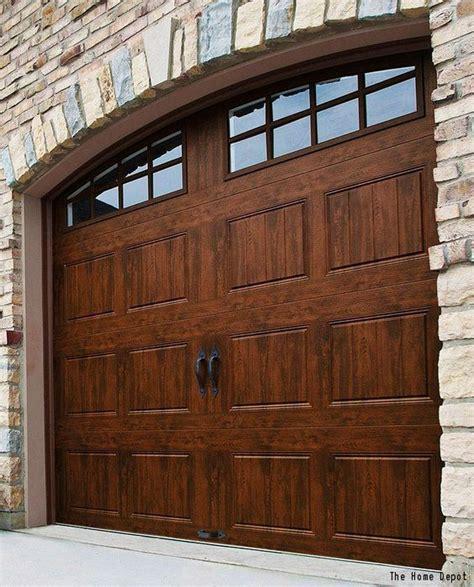 gorgeous wood garage  decorative windows   stone